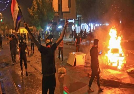 العراق.. مواجهات بين متظاهرين والأمن في كربلاء وقطع طريق مطار النجف