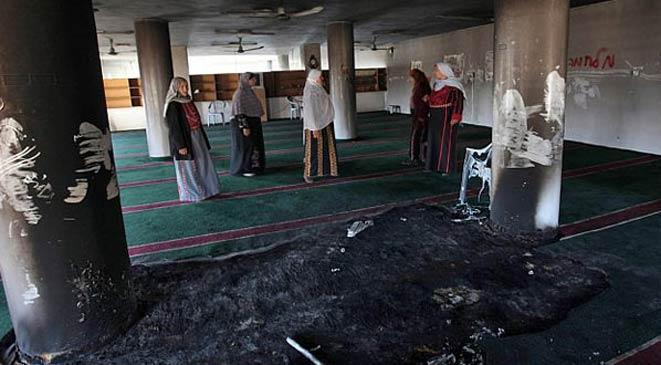 إدانة قطرية بحرينية لعملية إحراق مسجد وكنيسة بفلسطين