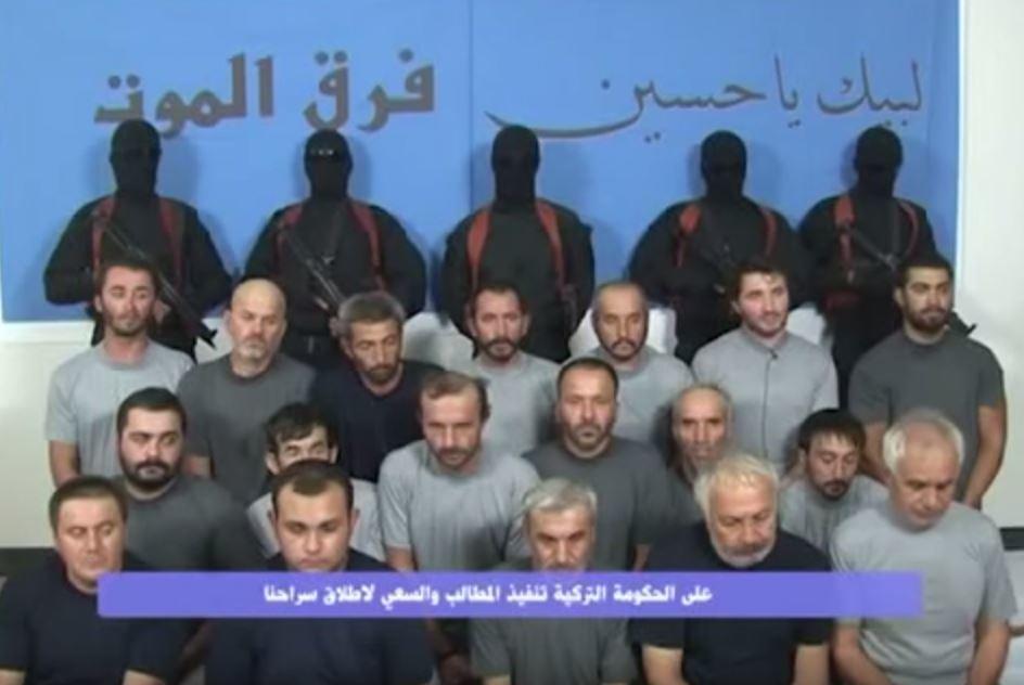 مجموعة شيعية تتبنى اختطاف 18 عاملاً تركياً ببغداد