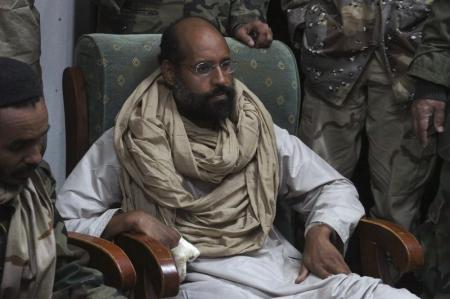 البدء محاكمة اثنين من أبناء القذافي ومسؤولين سابقين